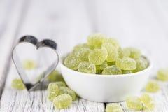 Kwaśny gumowaty cukierek (jabłczany smak) obraz royalty free