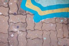 Kwadrat Malujący na Ceglanej dżdżownicie Fotografia Stock