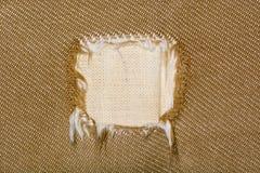 Kwadratowa dziura w tkaninie kanapa Zdjęcia Stock