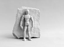 Kwadratowa skała z istotą ludzką Fotografia Royalty Free