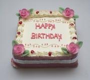 Kwadratowy urodzinowy tort dla dziewczyny zdjęcie stock
