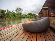 Cozy atmosphere and natural touch along Kwai Noi River,Sai Yok,Kanchanaburi,Thailand.With sofa bed on the balcony of the raft hous. Kwai Noi or Kwai Sai Yok is a royalty free stock images