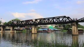 Kwai river bridge, Kanchanaburi. Thailand from below at river bank showing concrete supports stock video