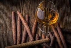 kwaliteitssigaren en cognac Stock Foto