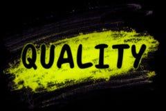 Kwaliteitswoord met gloedpoeder royalty-vrije stock foto