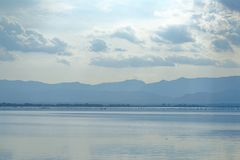 Kwan Phayao; a lake in Phayao province, the North of Thailand. Shooting with the rule of thirds between river, cloud, and sky. Kwan Phayao; a lake in Phayao stock photos