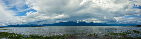 Kwan Phayao Panorama. Panoramic beautiful view with the blue sky, white cloud and mountain of Kwan Phayao that is located in Phayao, Thailand. Many water Royalty Free Stock Images