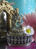 Kwan yin. Still life photograph of a small bronze kwan yin statue (female equivalent of the buddha Stock Image