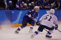 Team United States Blue in action against Team Slovenia during men`s ice hockey preliminary round game at 2018 Winter Olympics Royalty Free Stock Photography