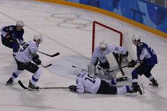 Team United States Blue in action against Team Slovenia during men`s ice hockey preliminary round game at 2018 Winter Olympics Royalty Free Stock Images