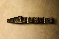 KWANTITATIEF - close-up van grungy wijnoogst gezet woord op metaalachtergrond Stock Afbeelding