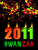 Kwanzaa candles lightning. With colorful bokeh Royalty Free Stock Images