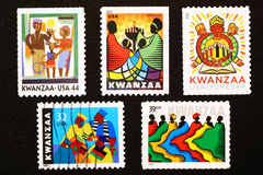 Kwanzaa celebró en sellos americanos Fotos de archivo libres de regalías