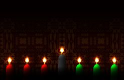 Kwanzaa. Concept of an African American festival in the United States. 7 candles of traditional colors. Ethnic patterns on the. Background stock illustration