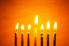 Kwanzaa seven candles. The symbol of the traditional holiday Kwanzaa seven candles for the background stock images
