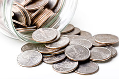 Kwarten de muntstukken van de 25 centenverandering in een glaskruik Stock Afbeelding