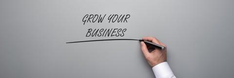 Kweek uw bedrijfstekst stock afbeeldingen