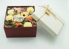 Kwiat w pudełku teraźniejszość fotografia stock