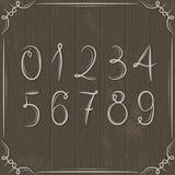 Kwieciste dekoracyjne granicy i liczby na drewnianych półdupkach Zdjęcie Stock
