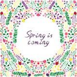 Kwieciste jaskrawe ramy z literowania ` wiosną są Nadchodzącym ` Fotografia Stock