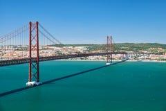 """25 Kwietnia mostu †""""zawieszenie most nad Tegus rzeką (Ponte 25 De Abril) lisbon Portugalia obraz stock"""