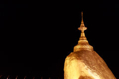 Kyaikhtiyo Pagoda at dusk in Myanmar. They are public domain or treasure of Buddhism, no restrict in copy or use. Royalty Free Stock Images