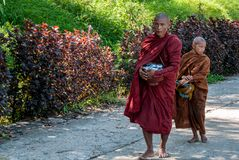 Buddhist monks to the Golden Rock stock photos
