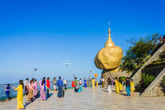 Kyaiktiyo Pagoda. Kyaiktiyo, Myanmar, Pagoda (Golden Rock) At daylight With Burmese people and tourists. Kyaiktiyo Pagoda is well-known Buddhist pilgrimage site royalty free stock image