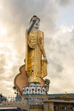 KYAINGTONG,MYANMAR : OCTOBER 2014 :Sunset at pointing Buddha statue Royalty Free Stock Photography
