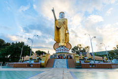 KYAINGTONG,MYANMAR : OCTOBER 2014 :Sunset at pointing Buddha statue Stock Photos