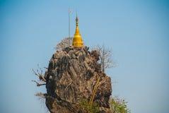 Kyauk Kalat Pagoda. Mawlamyine, Hha-an. Myanmar. Burma. Small pagodas have been erected on a steep rock. Royalty Free Stock Image