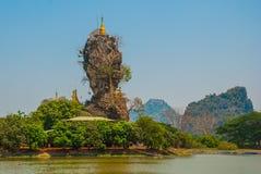 Kyauk Kalat Pagoda. Mawlamyine, Hha-an. Myanmar. Burma. Small pagodas have been erected on a steep rock. Royalty Free Stock Photos