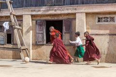 KYAUKME, MYANMAR - Dec 3, 2014: Young buddhist. KYAUKME, MYANMAR - Dec 3, 2014: Young buddhist monks playing footbal in the temple near Kyaukme in Shan state stock photos