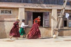KYAUKME, MYANMAR - Dec 3, 2014: Young buddhist. KYAUKME, MYANMAR - Dec 3, 2014: Young buddhist monks playing footbal in the temple near Kyaukme in Shan state royalty free stock photos