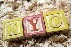 KYC Know Your Customer acronym on wooden blocks royalty free stock photography