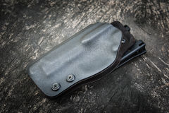 Kydex holster for pistol Stock Photography
