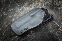 Kydex pistolhölster för pistol Arkivbild
