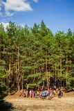 Young People in Forest wide vertical. Kyiliv, Kyiv region, Ukraine - 08 09 2017: A group of young people teenagers in a pine forest play rest are competing Royalty Free Stock Photo