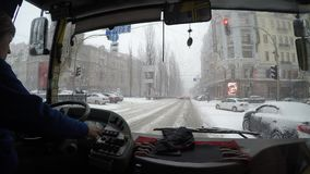 Kyiv, January, 2018, Ukraine. The trolleybus driver is driving along the snow-covered street in the city. Kyiv, January, 2018, Ukraine. The trolleybus driver is stock video footage
