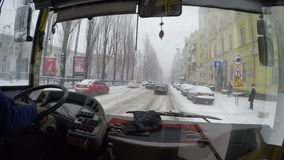 Kyiv, January, 2018, Ukraine. The trolleybus driver is driving along the snow-covered street in the city. Kyiv, January, 2018, Ukraine. The trolleybus driver is stock video