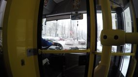 Kyiv, January, 2018, Ukraine. The trolleybus driver is driving along the snow-covered street in the city. Kyiv, January, 2018, Ukraine. The trolleybus driver is stock footage