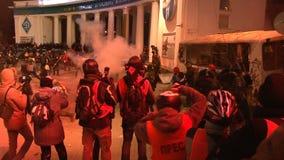 Kyiv. Maidan. Protesters throw stones and set fire to tyres on the barricade. KIEV, UKRAINE - JANUARY 20, 2014: Protesters attack police, throw stones and set stock video