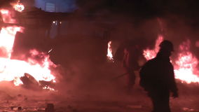 Kyiv. Maidan. Protesters throw stones and set fire to tyres on the barricade. KYIV, UKRAINE - NOVEMBER 22, 2014: The streets in the fire. Protesters throw stock video