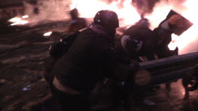 Kyiv. Maidan. Protesters throw stones and set fire to tyres on the barricade. KYIV, UKRAINE - NOVEMBER 22, 2014: The streets in the fire. Protesters throw stock footage