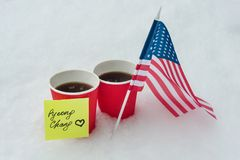 Kyiv UA, 21-12-2017, 2018 Winter Olympic Games with kinds of sport in PyeongChang, Republic of Korea,. The flag of the USA team, two cups of fans with coffee Stock Photos