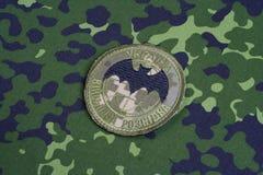 KYIV UKRAINA - Juli, 16, 2015 Emblem för militär underrättelse för Ukraina ` s enhetligt arkivfoto