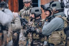 Group of soldiers during a briefing. KYIV, UKRAINE – OCTOBER 14, 2017: group of men in military uniform with body armor and weapons during airsoft royalty free stock photo