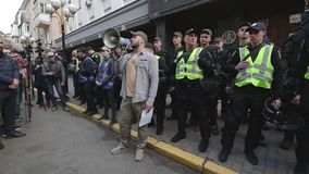Kyiv, Ukraine. April 9, 2019. Activists and supporters of the National Corps political party attend a rally to demand an investiga stock footage