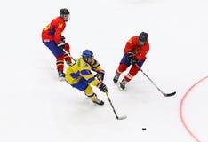 IIHF 2018 Ice Hockey U18 World Championship Div 1B. KYIV, UKRAINE - APRIL 20, 2018: Artem MATEICHENKO of Ukraine C fights for a puck with Adam VIZI L and Tamas royalty free stock photography