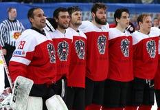 Ice Hockey 2017 World Championship Div 1 in Kyiv, Ukraine. KYIV, UKRAINE - APRIL 25, 2017: Austrian players listen to National anthem after the IIHF 2017 Ice Stock Image